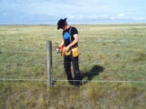 AFGA volunteer putting in wildlife friendly fencing