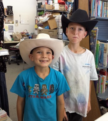Boyd and Reyd trying out cowboy hats