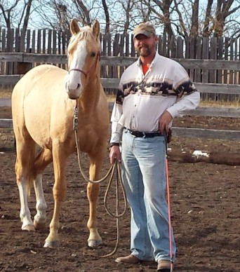 Neal standing with a horse