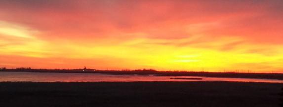a beautiful winter sunrise over the frozen lake