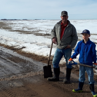 Neal and Reyd draining some water off the roads