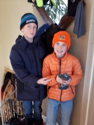 The boys have caught the pigeon that has been living with the chickens all winter