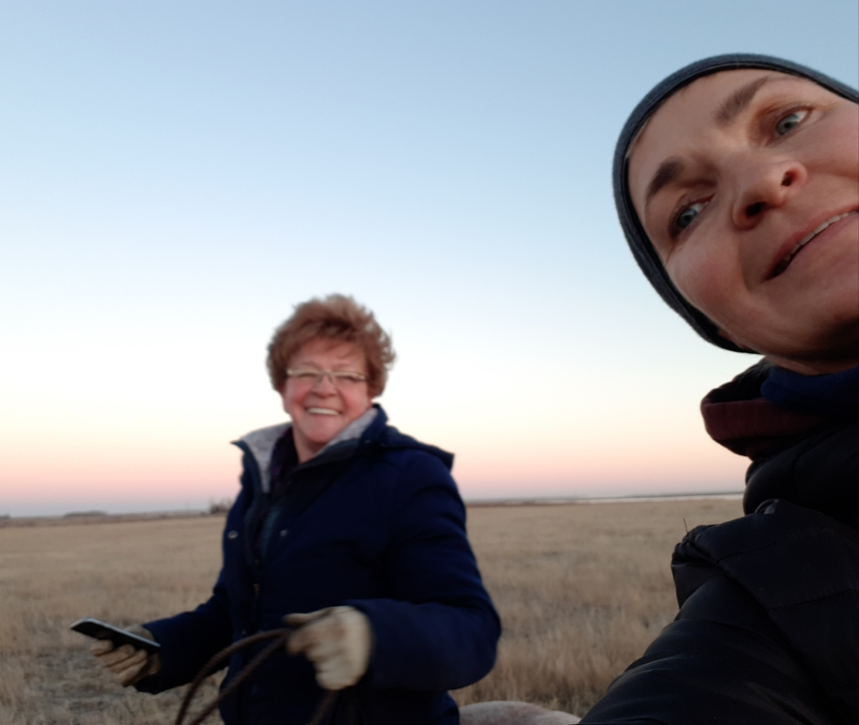 My mom out for a ride on the prairie